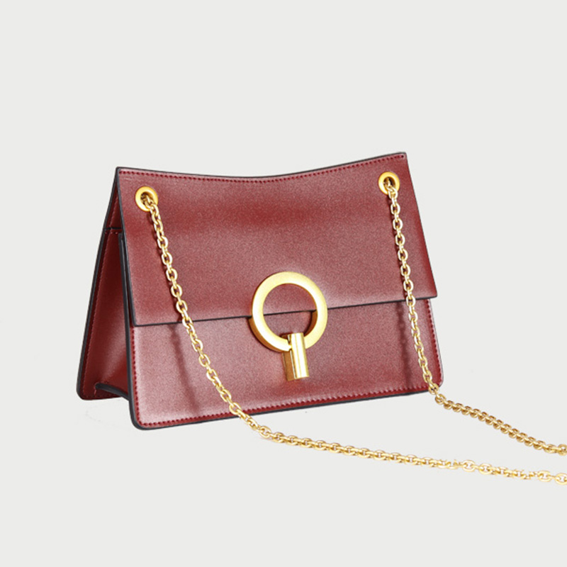 our leather and gold crossbody bag for women