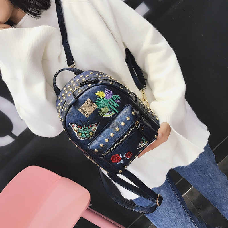 Korean version of the tide 2018 new retro embroidery rivets backpack casual wild multi-purpose small bag 31