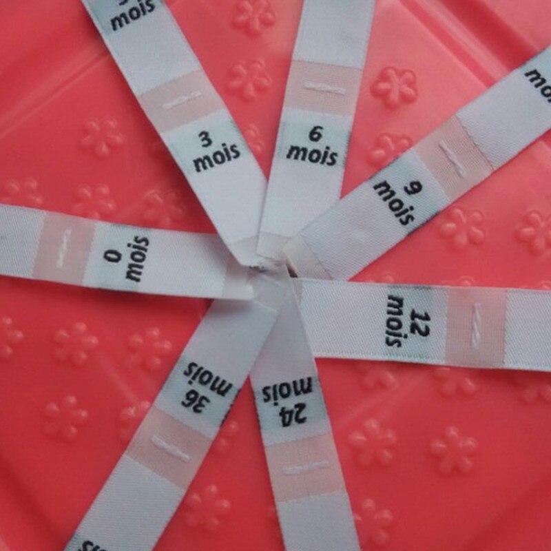 0, 3, 6, 9, 12, 18, 24, 36 Mois Voorraad Wit Polyester Geweven Doek Frankrijk Size Label Bekwame Vervaardiging