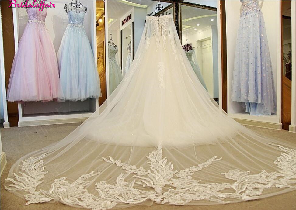 Image 5 - Real Image Luxury Wedding Dresses 2019 Vsetido De Novia Crystals Lace Wedding Dresses Beading Appliques Royal Train Bridal Gowns-in Wedding Dresses from Weddings & Events