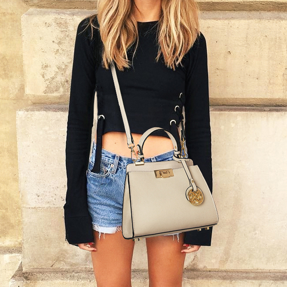 JIANXIU marka kobiety prawdziwej skóry torebki znanych marek Messenger torby mała torba na ramię pomponem metalowy zamek torby na ramię w Torebki na ramię od Bagaże i torby na  Grupa 2