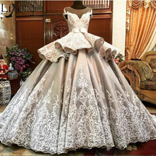 Luxury Wedding Dress 2019 Sheer Neck Cap Sleeve Lace Appliques Bridal Gowns  Peplum Ball Gown Satin 3c37a331f214