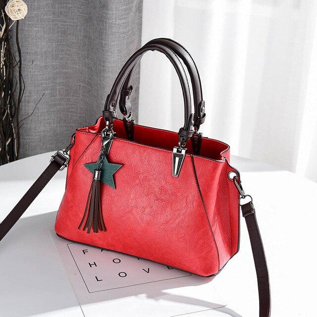 d35734ad3bc Otoño Invierno mujeres borla estrella de cinco puntas carteras bolsos  señora diseñadores bolsas de hombro mujer