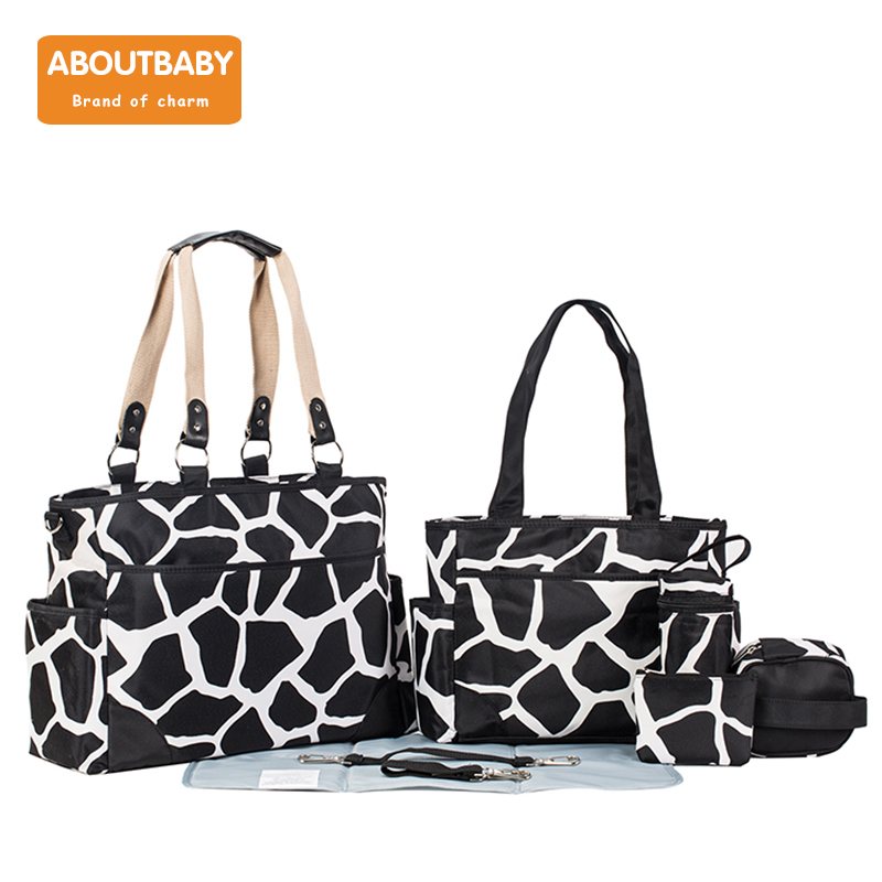Multifunctional Mummy Maternity Diaper Bags Change Pad Hooks Tissue Box Baby Bag Travel Nappy Bag New Fashion Diaper Tote BagMultifunctional Mummy Maternity Diaper Bags Change Pad Hooks Tissue Box Baby Bag Travel Nappy Bag New Fashion Diaper Tote Bag