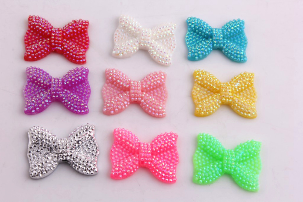 OYKZA  High Quality  Middle Vertical Hole 21x28MM Shinny Resin Rhinestone Bows Beads For Kids Chunky Jewelry 100PCS A Lot