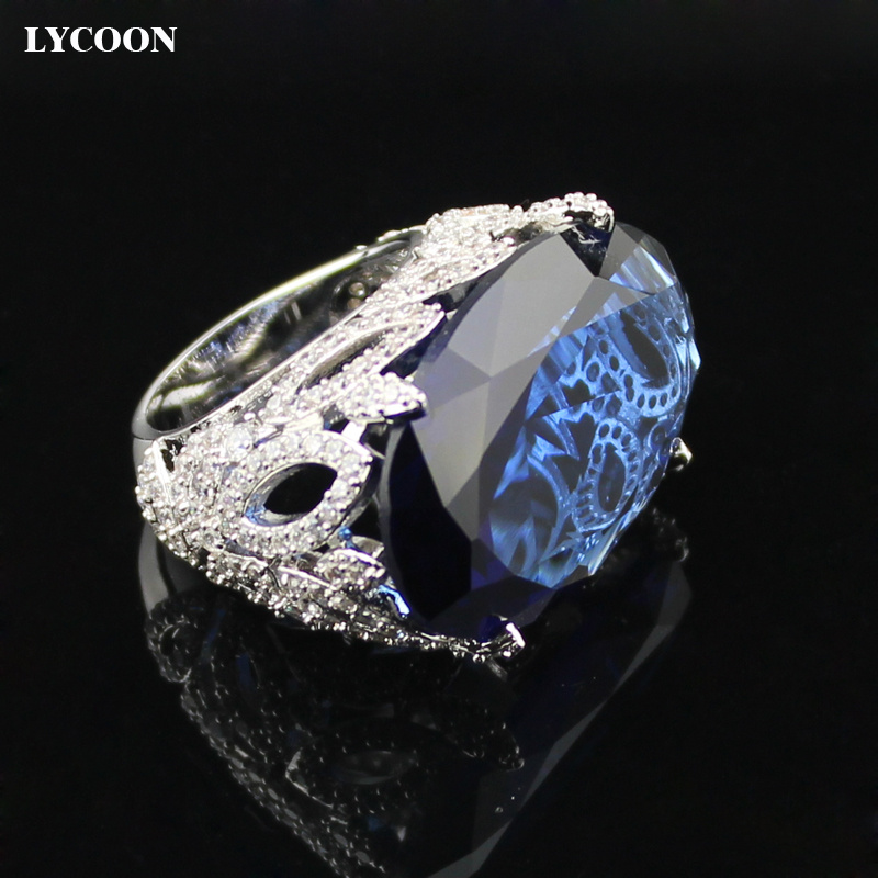 все цены на LYCOON Newest fashion party ring silver plated dark blue Oval big Crystal rings prong setting Cubic Zirconia in flower design