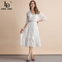 LD LINDA DELLA 2019 Fashion Runway Summer Pure White Dress Women's Flare Sleeve V Neck Hollow out Slim Show Thin Holiday Dress