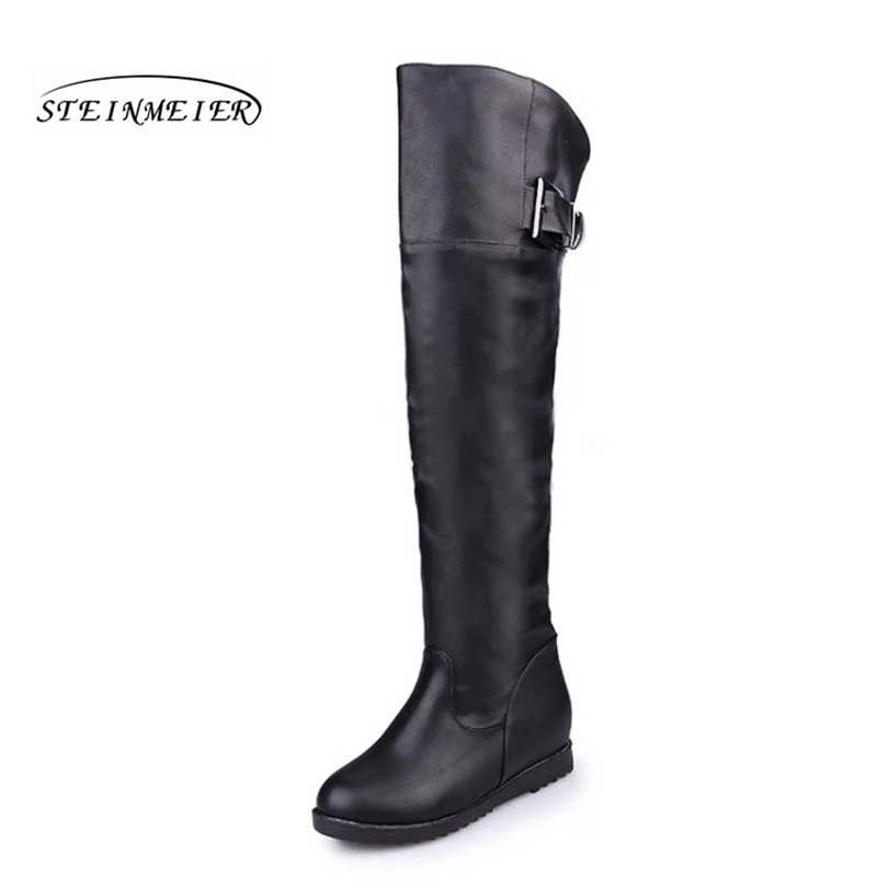 Kadınlar uzun kış peluş çizmeler kaliteli PU diz yüksek siyah moda botlar artan topuk 2 cm rahat yuvarlak ayak çizmeler ayakkabı