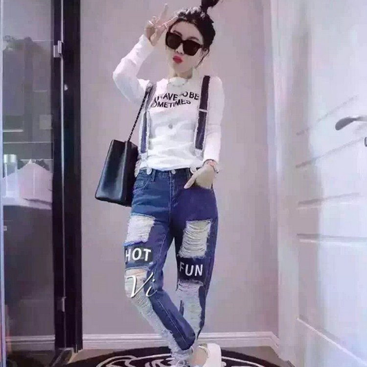 The spring of 2016 Europe fashion big hole washing jeans all match letter sling spot female