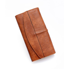 New wallet lady retro style, long three-fold clutch, one generation of coin purse three fold wallet long section of new leather embossed clutch bag purse ms bb055