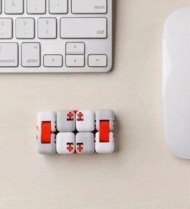 Image 3 - XiaoMi bloques de construcción Mitu Finger Bricks Mi, Spinner de dedo Original, regalo para niños, construcción portátil de seguridad, Mini juguetes inteligentes
