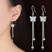 d2825d91 Dulce temperamento pendientes largos borla Corea moda mariposa pendientes  para las mujeres chica mujer Hollow remolino