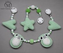 Купить с кэшбэком MIYOCAR handmade wood clip green Crochet heart with  stroller toy chain for pram stroller mobile rattle wooden bead crochet