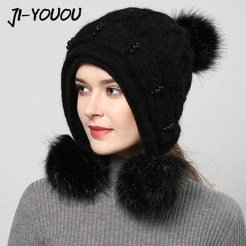JIYOUOU gorros de invierno para mujeres bombardero sombreros hecho a mano  2018 las nuevas mujeres de sombrero rojo de punto pompón colores sólidos  gorros ... 8bf315a3887