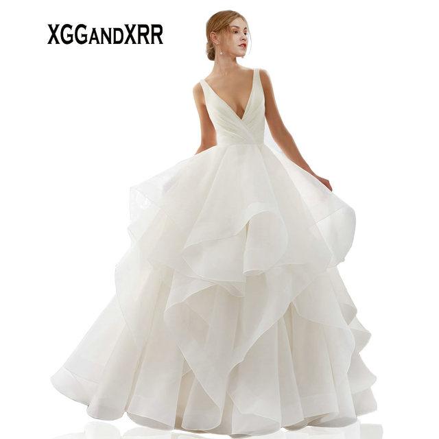 XGGandXRR Romantic Ball Gown Organza Wedding Dress 2019 Sexy V Neck Backless Pleated Long Bridal Gown Ruffles Skirt