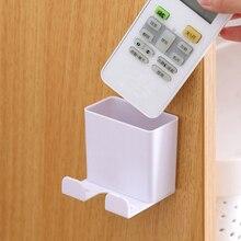 1PC de teléfono soporte de pared estante de almacenamiento montado Smartphone colgante móvil carga de tablet soporte de Control remoto