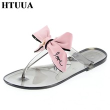 HTUUA 2019 New Fashion Crystal Bow Slippers Women Jelly Sandals Flat Slides Casual Beach Flip Flops Summer Jelly Shoes SX2180(China)