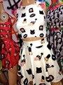 Estilo quente de Verão 2 Peça Set Mulheres Top de Culturas E Conjunto Saia Mulheres Ternos Casual Emoji Preto Unha Polonês Tanque Imprimir Mini Saias Conjuntos