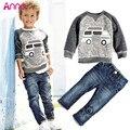 2015 Más Nuevos de Los Niños que arropan la camiseta + pantalones 2 unids/set otoño bebé del muchacho Infantil coche de manga larga pantalón de mezclilla pantalones vaqueros