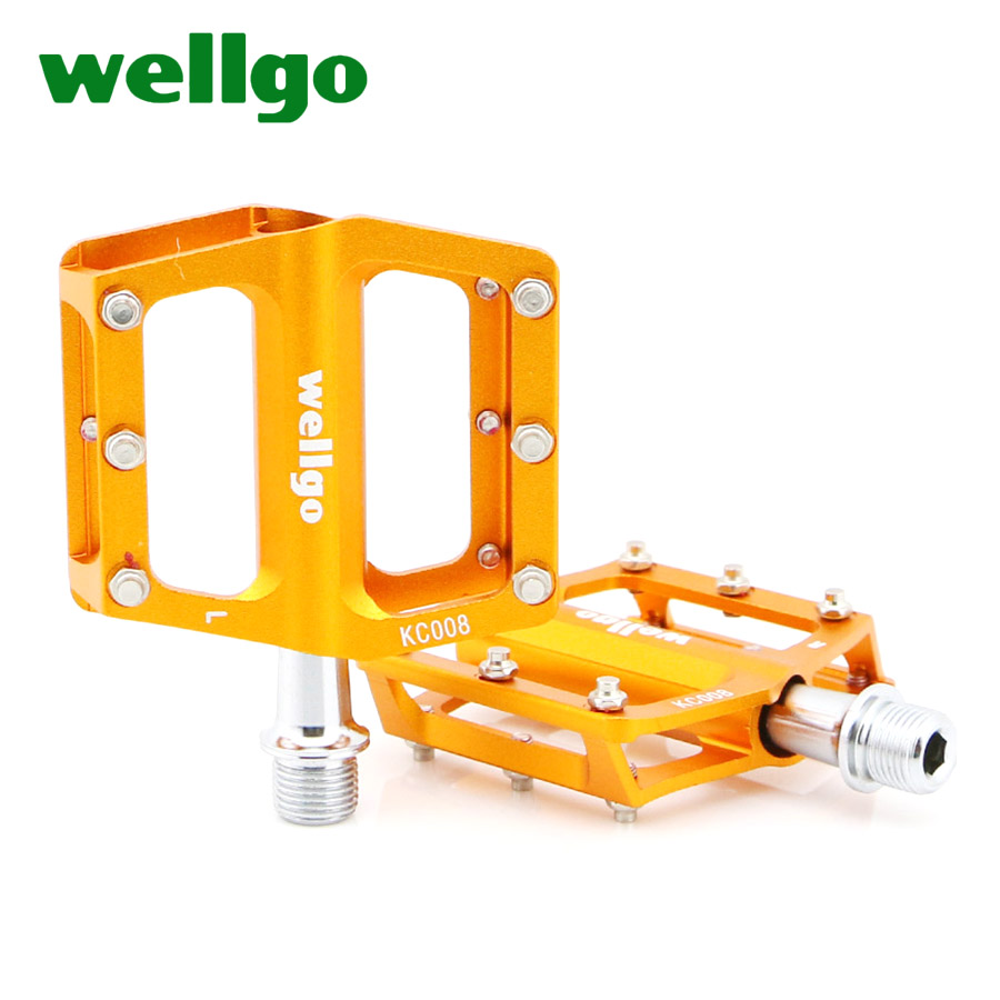 ФОТО Hot Sale Wellgo Bike Pedals Aluminum Alloy Mountain Road BMX Bicycle Pedals Cr-Mo Steel 75*70*14mm 4 Colors KC008 Cycling Parts