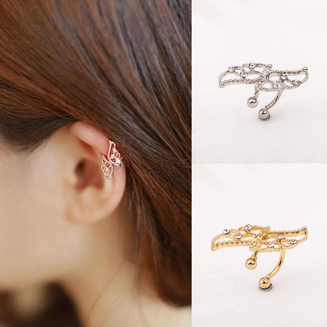 1b5da7b6c2dd Chicas Punk pendientes de oro hueco cristal alas sin orejas earclip  brazalete pendientes de Clip pendientes
