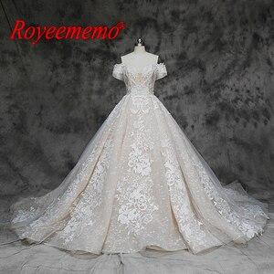 Image 1 - 새로운 럭셔리 레이스 디자인 웨딩 드레스 어깨 짧은 소매 웨딩 드레스 공장 사용자 정의 만든 도매 가격 신부 드레스