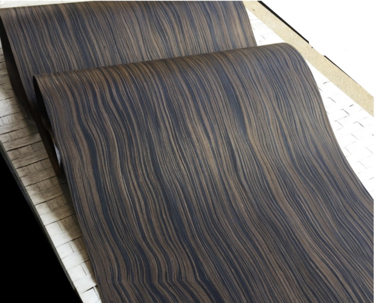 1Pieces  L:2.5Meters Wide:55cm  Thickness:0.25mm  Technology Wave Pattern Macassar Ebony Wood Veneer(back Nonwoven fabric)