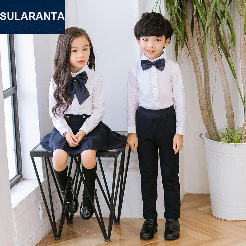 191be28fcc Niños algodón japonés coreano estudiante escuela uniformes conjunto para  niñas niños camisas blancas azul marino falda pantalones corbata ropa