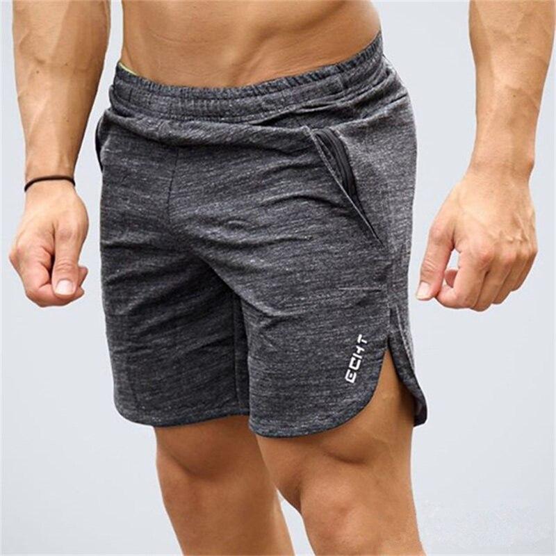 Mens gimnasio algodón correr deportes Fitness bodybuilding Sweatpants hombre profesión entrenamiento pantalones cortos de la marca