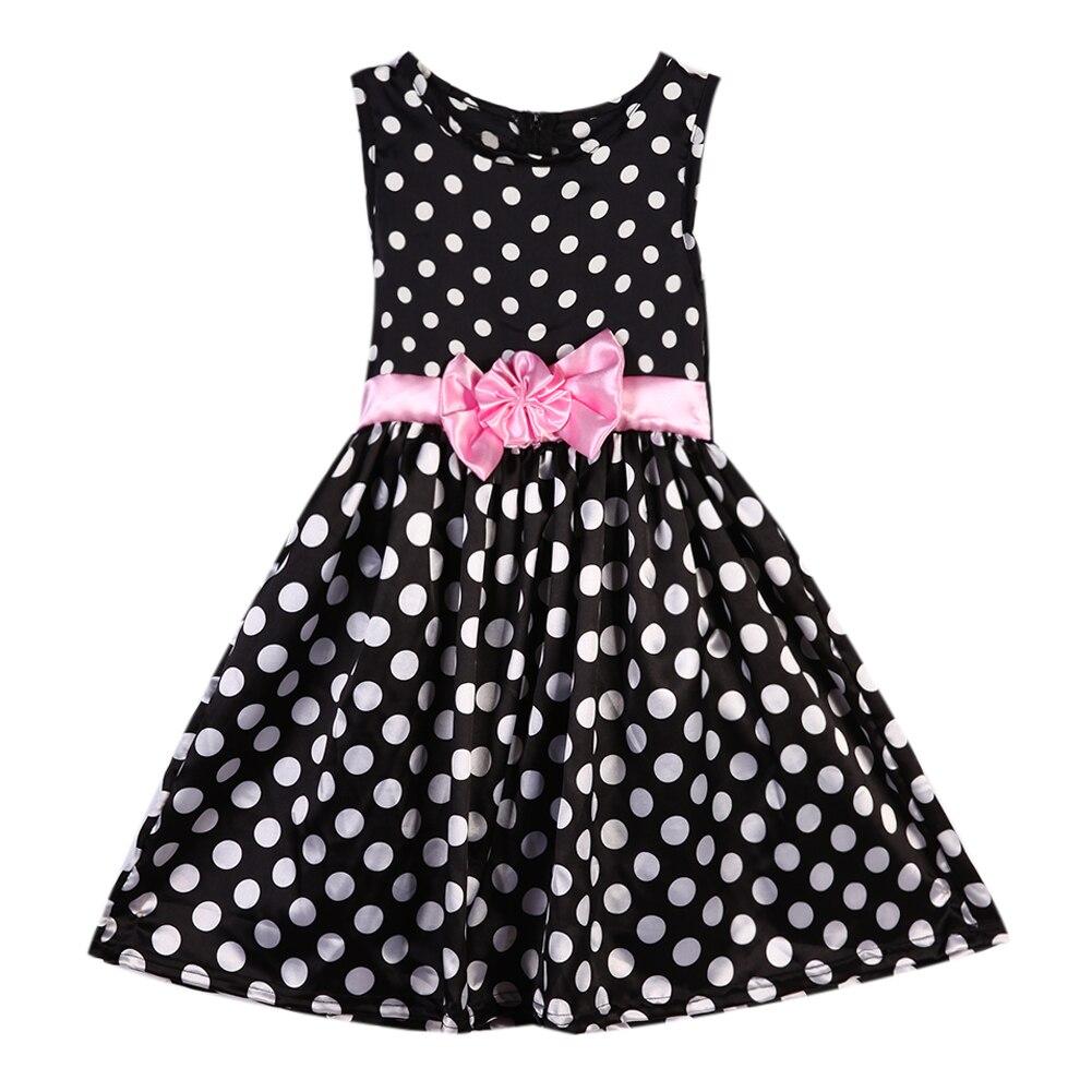 Zwarte jurk met roze strik
