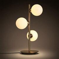 https://ae01.alicdn.com/kf/HTB1bj0JKv5TBuNjSspmq6yDRVXaP/Nordic-Minimalist-Art-โมเลก-ลตารางโคมไฟโรแมนต-ก-Golden-Creative-โลหะแก-วศ-กษาข-างเต-ยง-Cafe-โรงแรม-Led.jpg