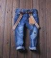 Новый 2015 мальчики разорвал джинсы по уходу за детьми в целом брюки брюки джинсы одежда новое поступление дети мода брюки одежда бесплатная доставка