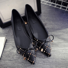 Free shipping women's spring shallow mouth bowknot singles shoes pointed toe rivets flat shoes
