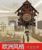 Cuckoo clock cuckoo clock clock pendulum control manual solid wood engraving European clock retro living room watch
