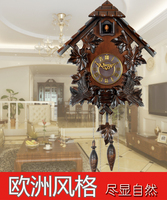 Cuckoo clock cuckoo clock clock pendulum control manual solid wood engraving European clock retro living room watch