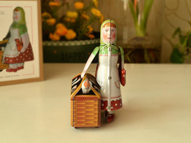 Woman with Goose Wind Up Toy