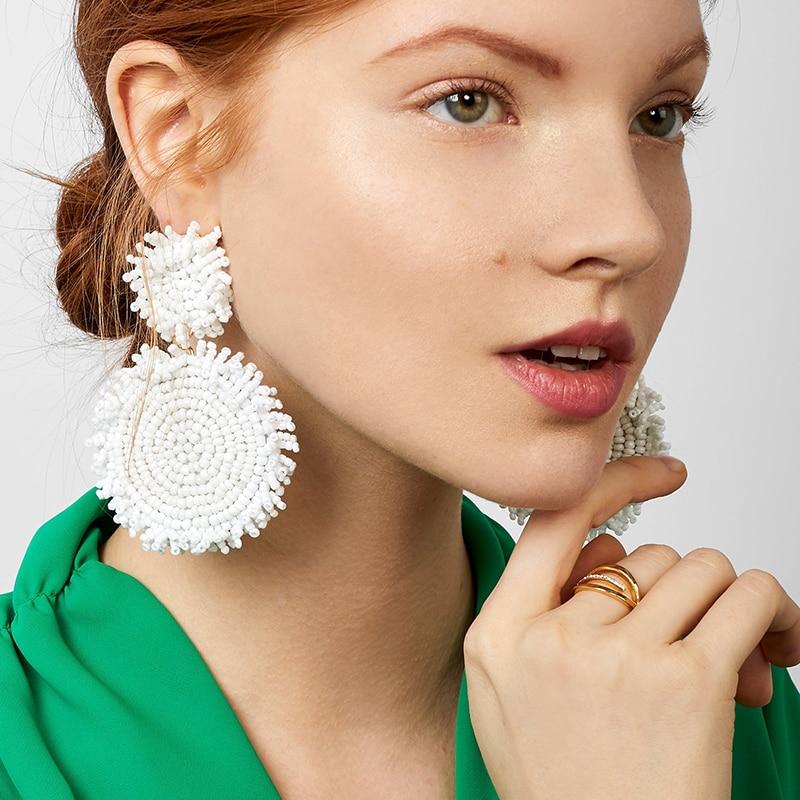 Dvacaman White Big Earrings Women Trendy Beads Flower Tassel Fringes Dangle Drop Earrings Handmade Statement Earrings Wholesale