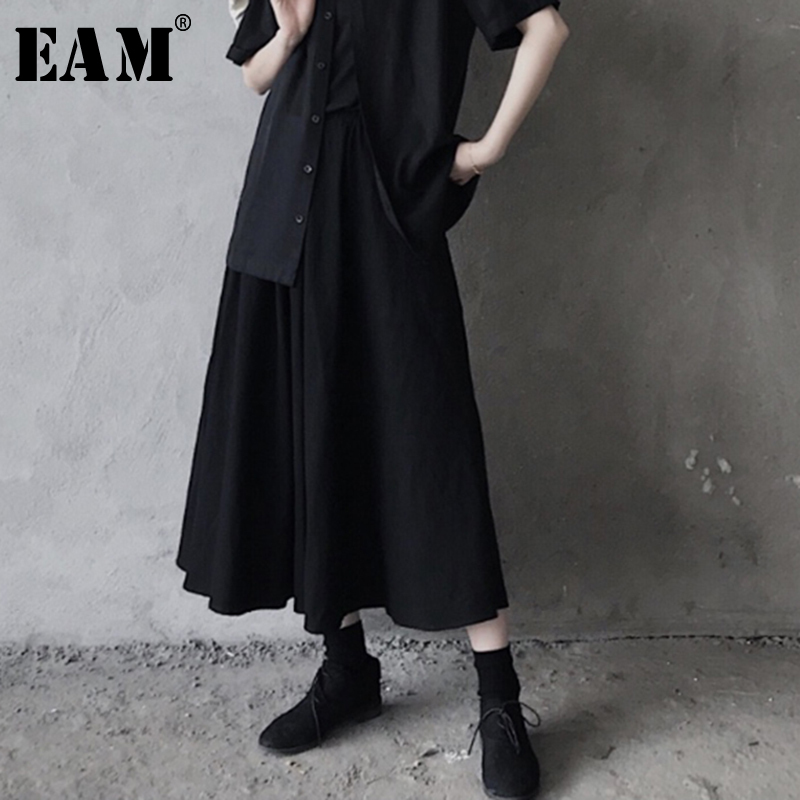 EAM 2019 New Spring Summer High Elastic Waist Black Pleated Irregular Brief Loose Half body