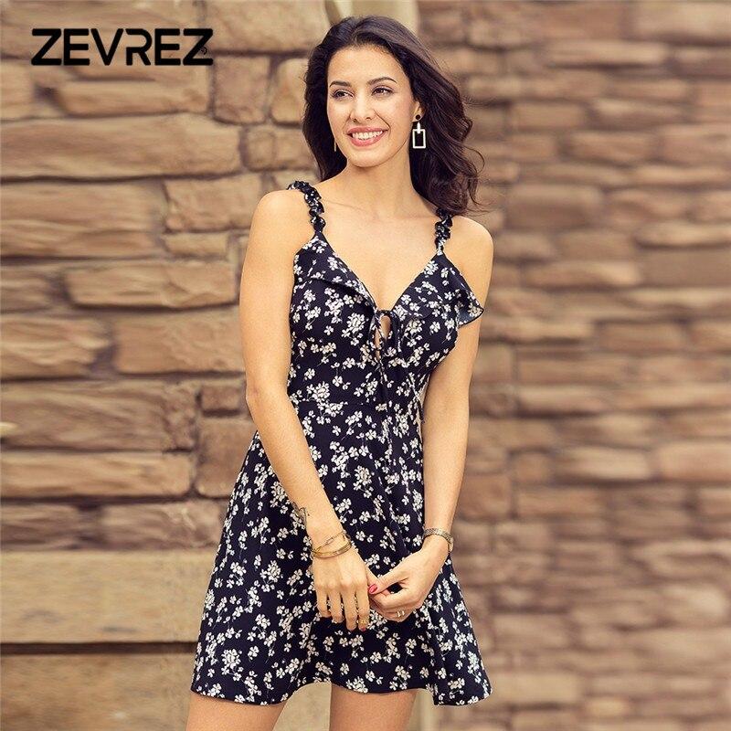 2018 verano estampado Floral mujeres vestido de volantes Correa atado cuello pico playa vestido negro Sexy espalda descubierta corto Mini vestido más tamaño Zevrez