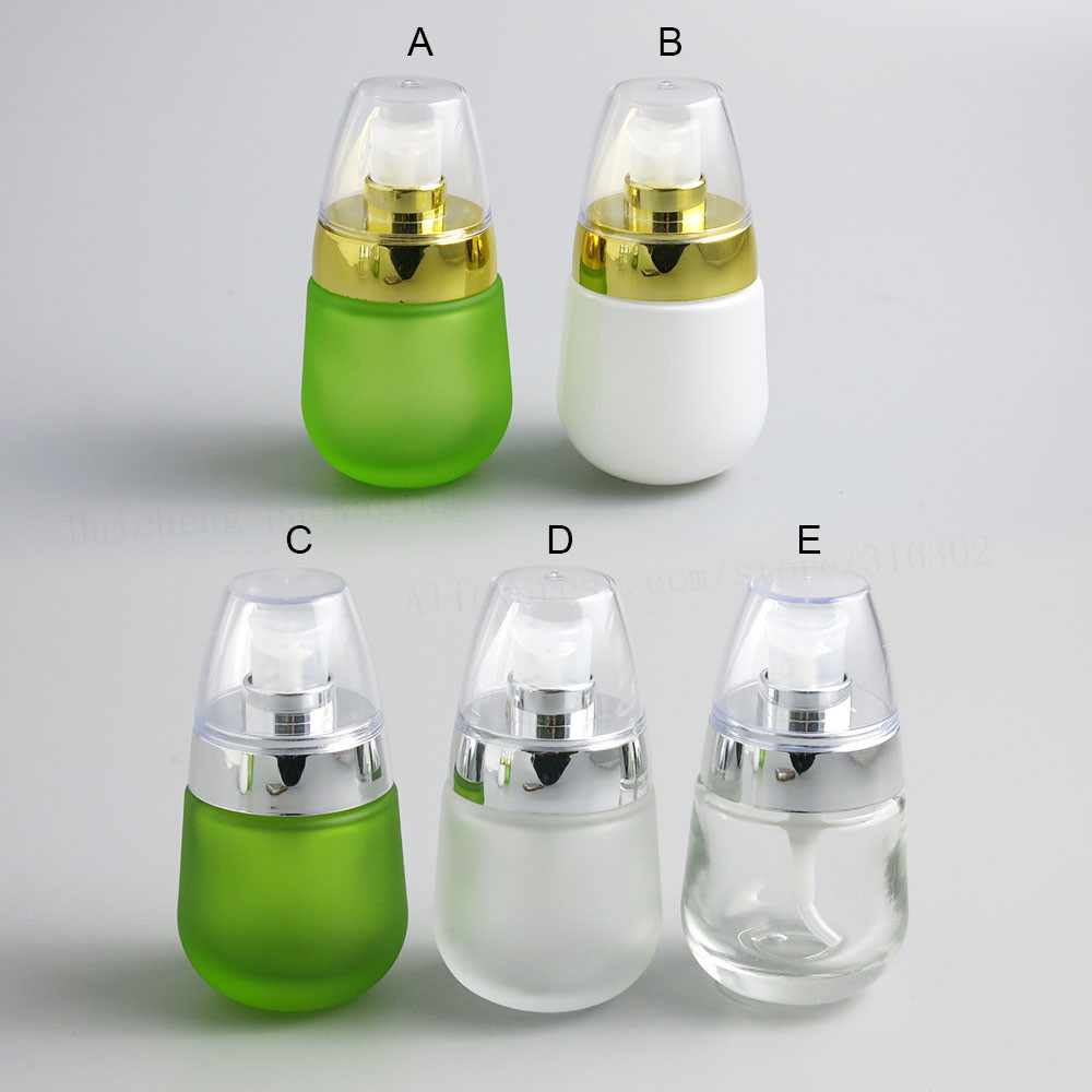 12 x 30ml glass lotion bottle 1 oz clear green glass bottle with silver lotion pump
