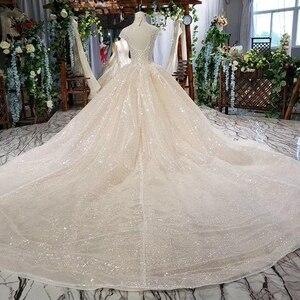 Image 2 - HTL639 brilhantes vestidos de casamento com brilho de alta pescoço cap luva de cristal vestidos de casamento do laço com trem vestidos de novia vindima