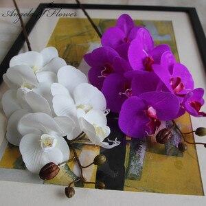 Image 1 - Orquídea de mariposa de poliuretano Real al tacto, flores artificiales para casa, decoración de fiestas de bodas, regalo de Navidad