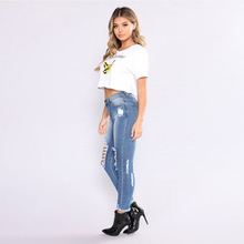 New autumn and winter popular European fashion personality hole fringed high-waisted ladies casual jeans