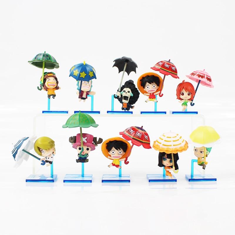 5-7cm 10pcs/lot One Piece kawaii figure model toys with blue base takes the umbrella cute Monkey Luffy Nami Tony Tony Chopper