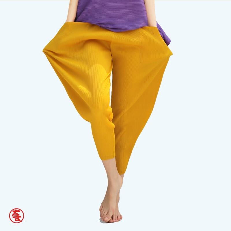 Specjalne zakładki kobiety na co dzień luźne szerokie spodnie nogi wiosna lato nowych kobiet plisowana długość łydki spodnie czarny żółty zielony spodnie w Spodnie i spodnie capri od Odzież damska na  Grupa 1