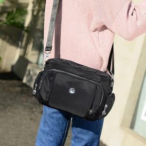 Image 5 - DIZHIGE di Marca di Grande Capienza Impermeabile Borsa A Tracolla In Nylon Multi tasca Borsa Delle Donne Solido di Alta Qualità Crossbody Bag Per Le Donne