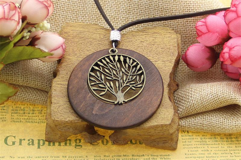 Pendentif arbre de vie en bois + métal
