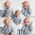 Ins * nueva llegada 2015 unisex bebés y niños patrón de ojo de algodón sudaderas niños otoño top sudaderas con capucha Fleece suéter tejido