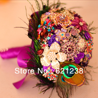 Holding purple flower brooch for Purple Wedding Jewelry & peacock feathers creative bouquets, bride holding flowers