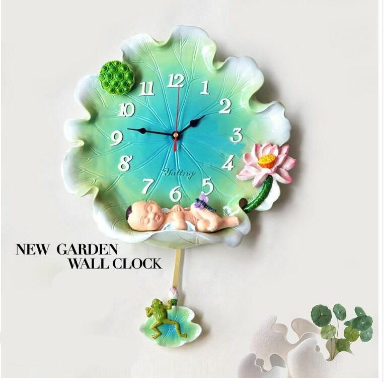 48c5683f23cb Compre Continental Lotus Angel Reloj De Pared Creativo Dormitorio ...